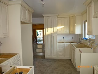 Kitchen Remodel – Upper cabinets and counter-top install